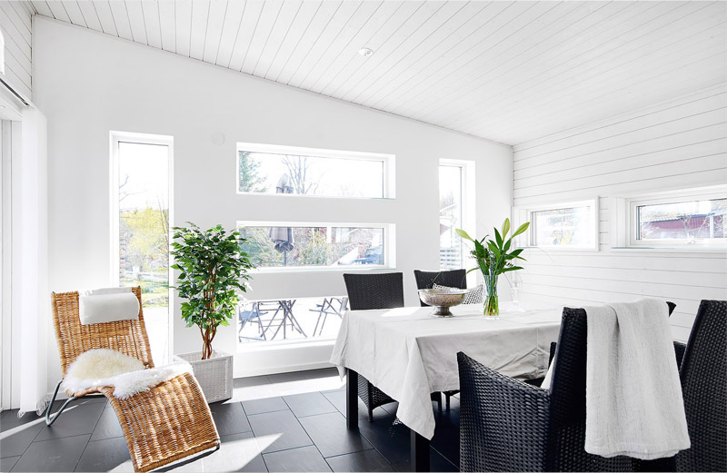white-dining-room-with-big-windows