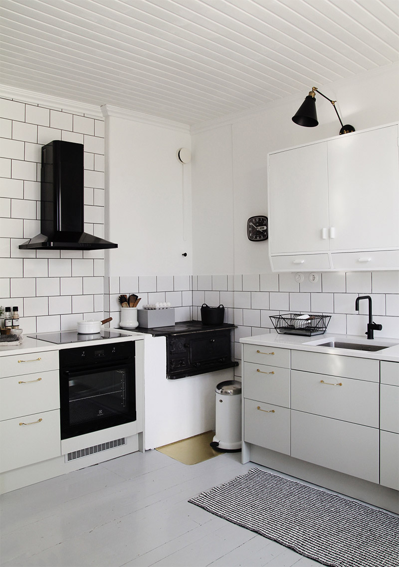 White Kitchen With Black And Brass Details