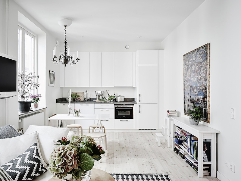 Scandinavian studio apartment with bright white interiors