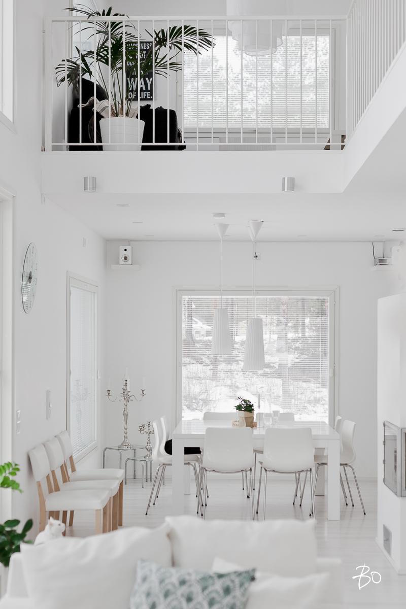 Designing home interior in a pure white palette for Dining hall interior design