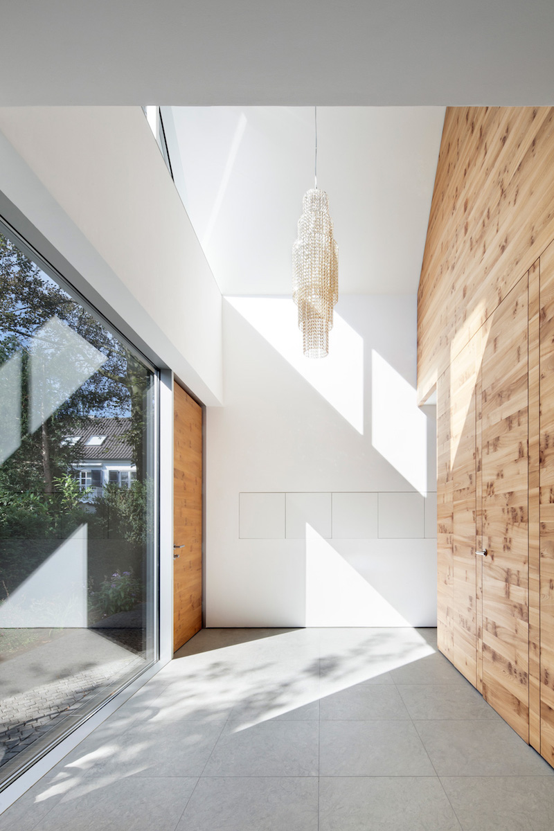 Wooden element in the middle dividing the rooms of the house for Architecture and interior design