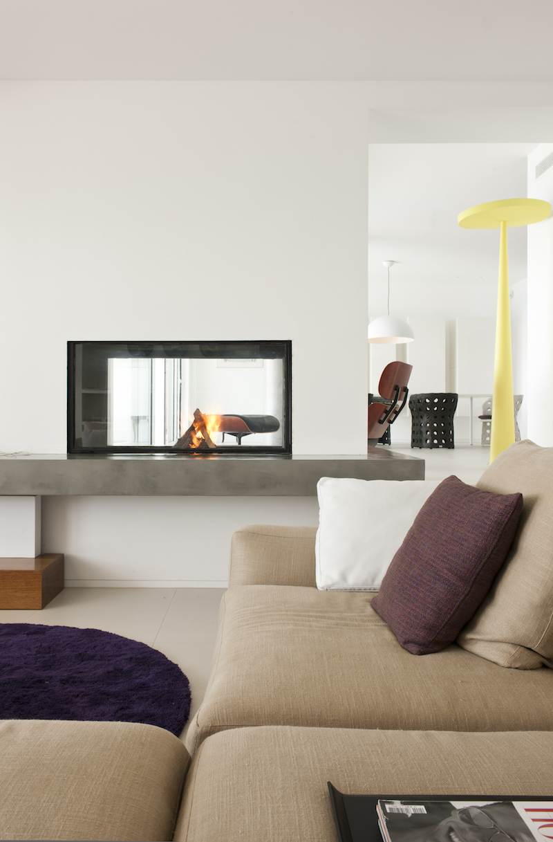 see-through-fireplace-duplex-apartments-into-single-residence
