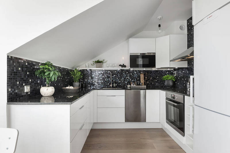 Earthy interior design of a compact scandinavian apartment for Earthy kitchen designs