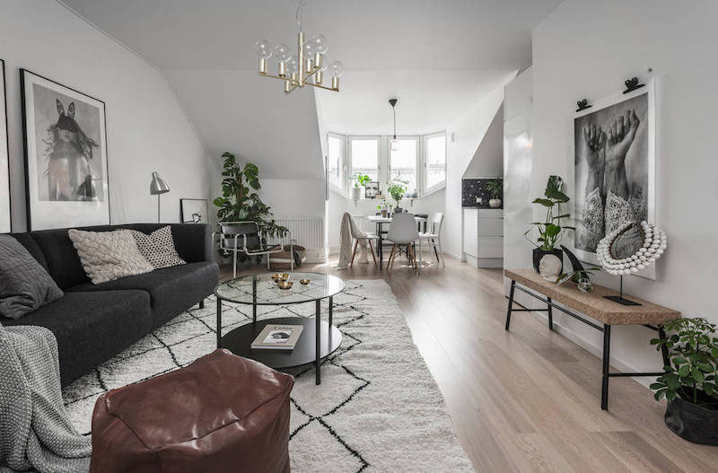 Earthy interior design of a compact scandinavian apartment for Earthy apartment decor