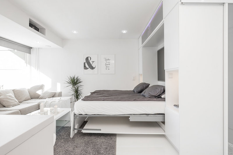 white-interior-small-apartment-wallbed-open