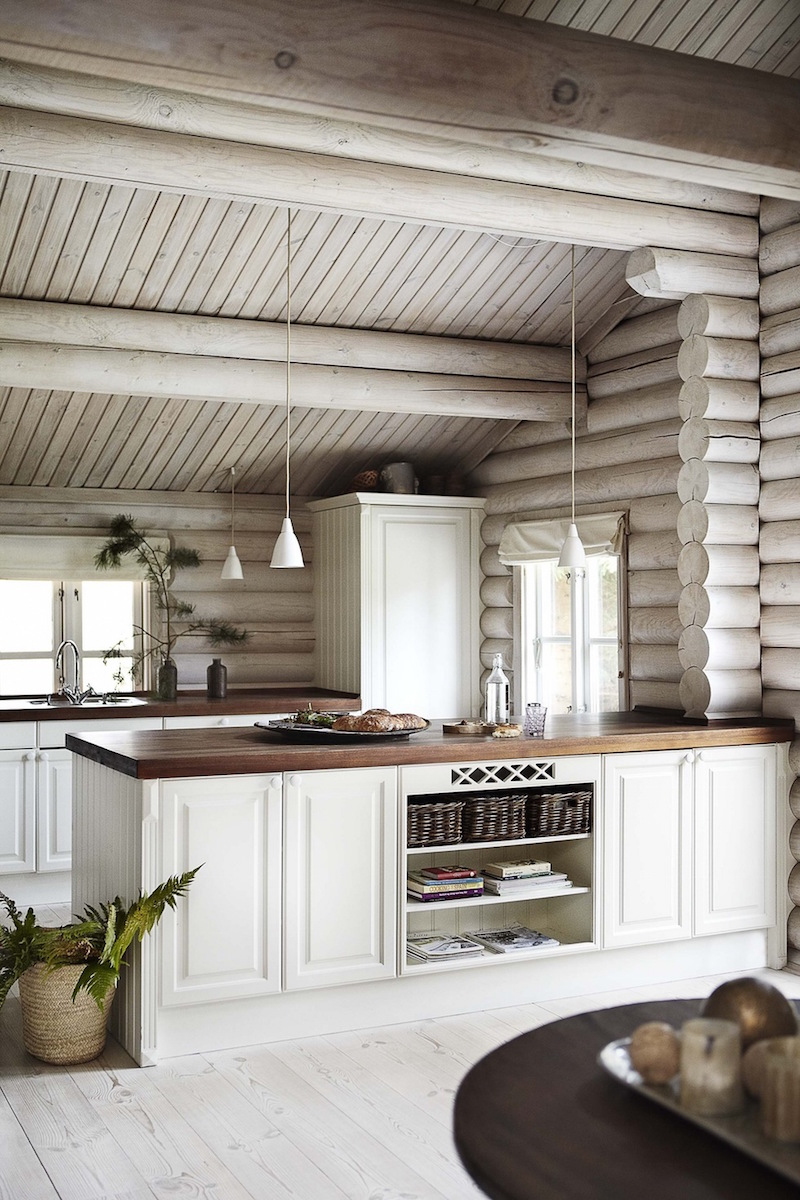 white kitchen cabinets in a log home black stained log cabin in danmark 28818