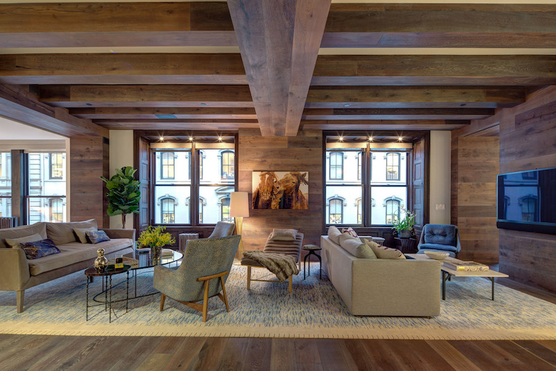 wood paneling and flooring creating a warm home atmosphere