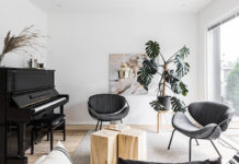 Living room area with black piano